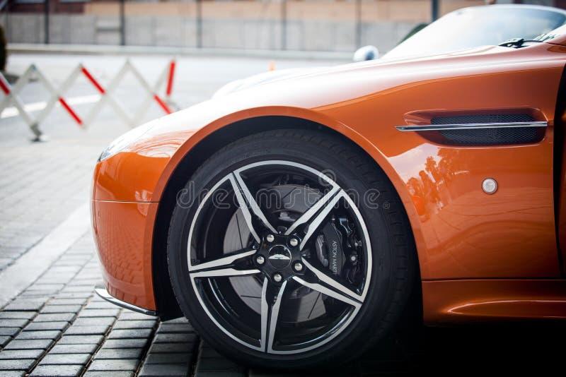 Orange Car Parked Near Grey Triangular Sign during Daytime stock photos