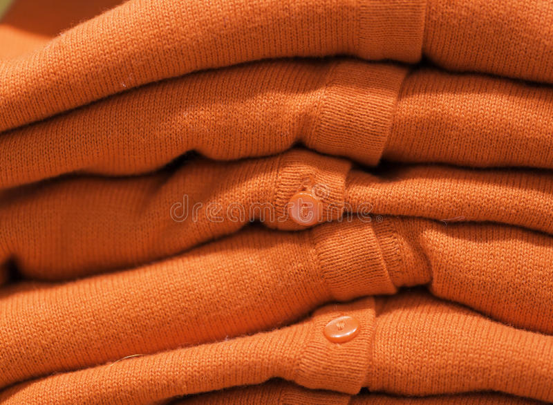 Orange Cardigans in a Stack.  stock photography