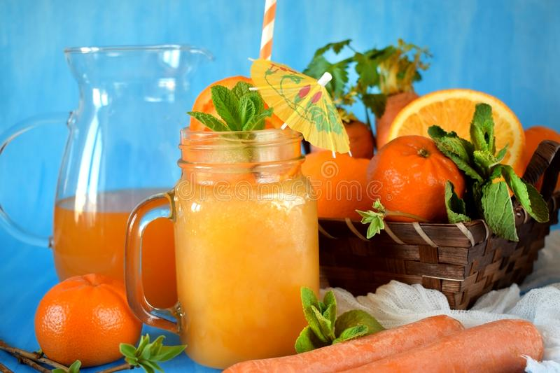 Orange and carrot juice in a glass jar stock photo