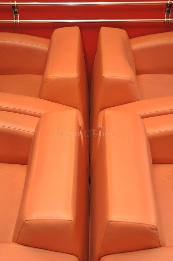 Orange chairs stock photos