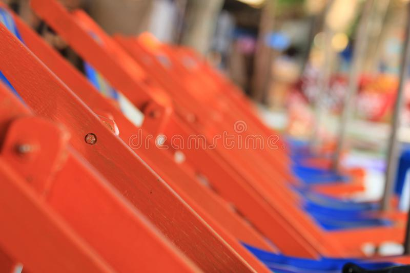 The orange chairs pattern on the Thailand beach. The orange chair pattern for relaxation at the beach in Thailand royalty free stock photography