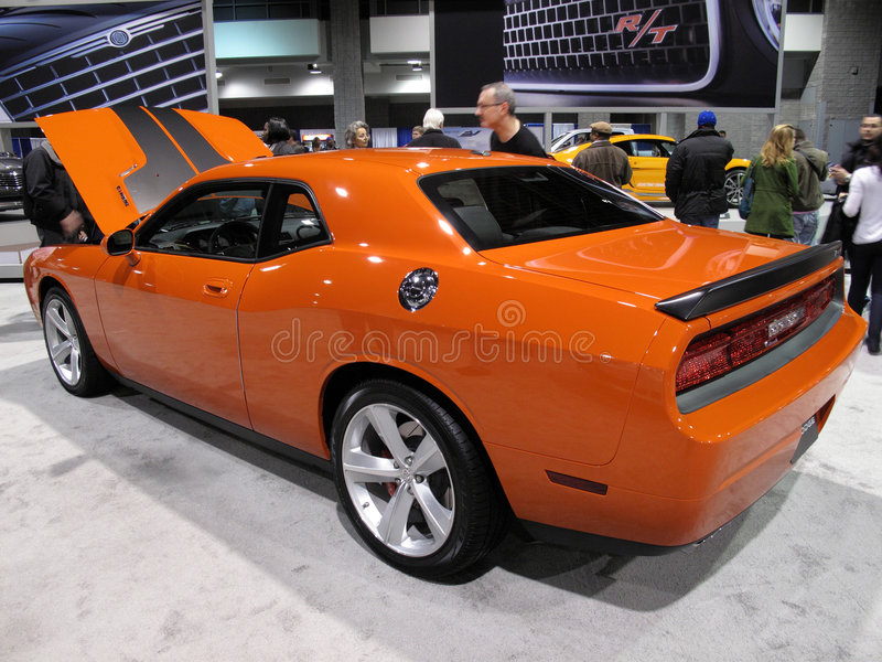 Orange Challenger. Photo of Dodge Challenger at the Washington D.C. auto show on 2/6/09. This muscle car is available with an economical V6 and a more powerful stock image