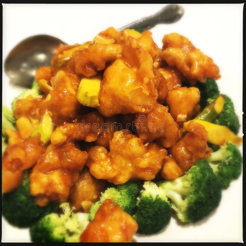 Orange chicken with broccoli royalty free stock photos