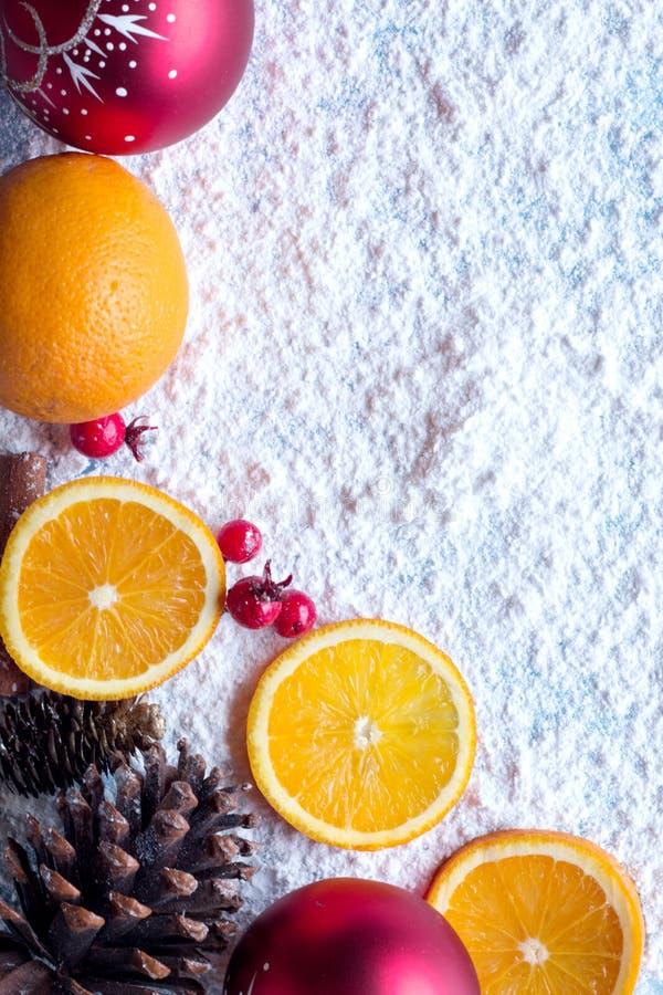 Orange christmas fruit with cinnamon and star anise spice, mistletoe and snow background. Orange christmas fruit with cinnamon and star anise spice, mistletoe royalty free stock image