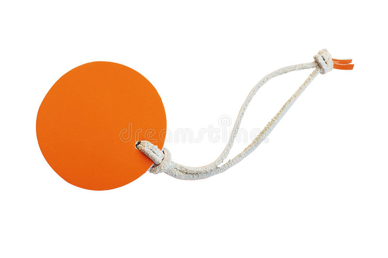Orange circle leather price tag with leather cord isolated on white background royalty free stock images