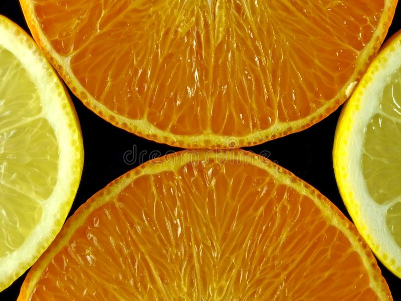 Orange and citron. In a nice arangement isolated in a black background stock photos