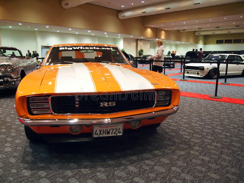 Orange Classic Camaro RS Car with a racing strip on display stock photos