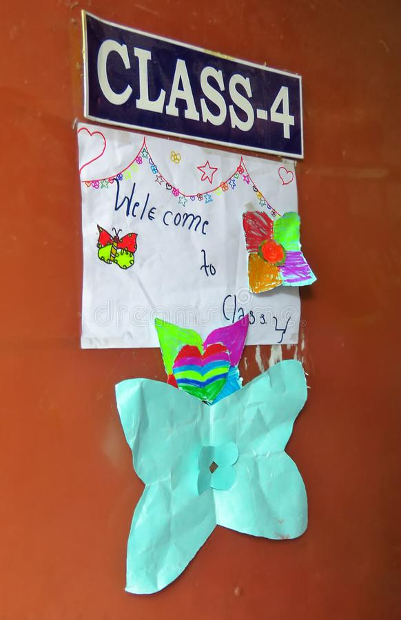 Children of class 4 decorated the classroom door with drawings, Kathmandu, Nepal. Orange classroom door decorated with children`s drawings, class 4, Kathmandu royalty free stock photography