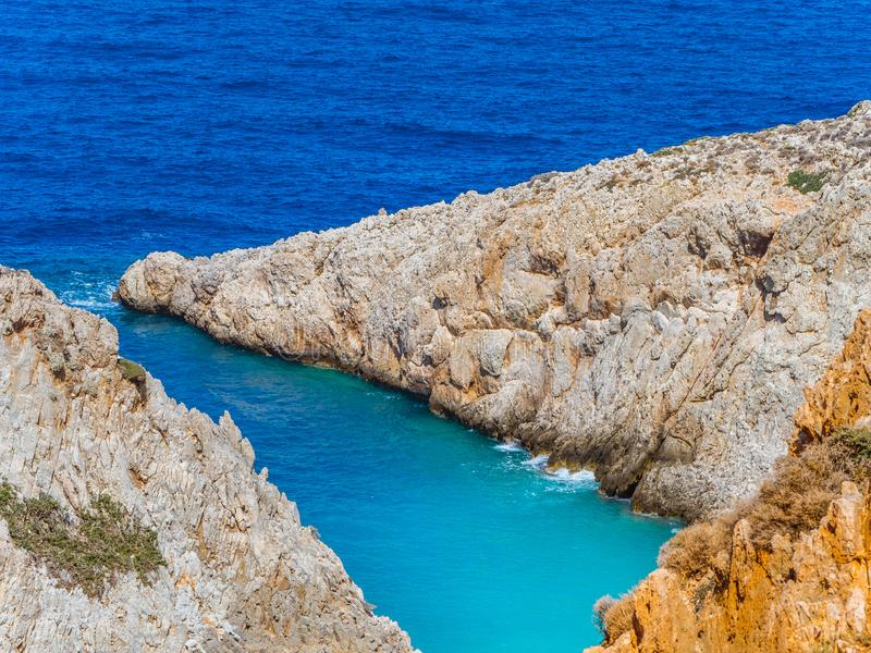 Orange cliffs and beautiful blue sea - Crete, Greece royalty free stock photography