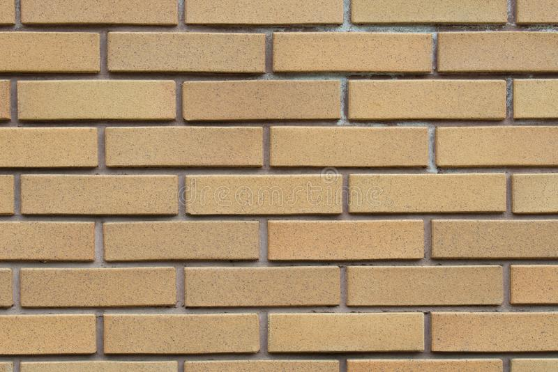 Orange clinker brick wall background. Texture royalty free stock images