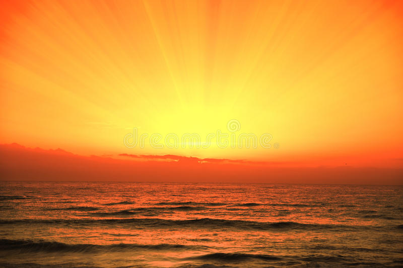 Orange cloudy sky, sunset time on the beach. Background and Empty copy space. For editor`s text stock photography