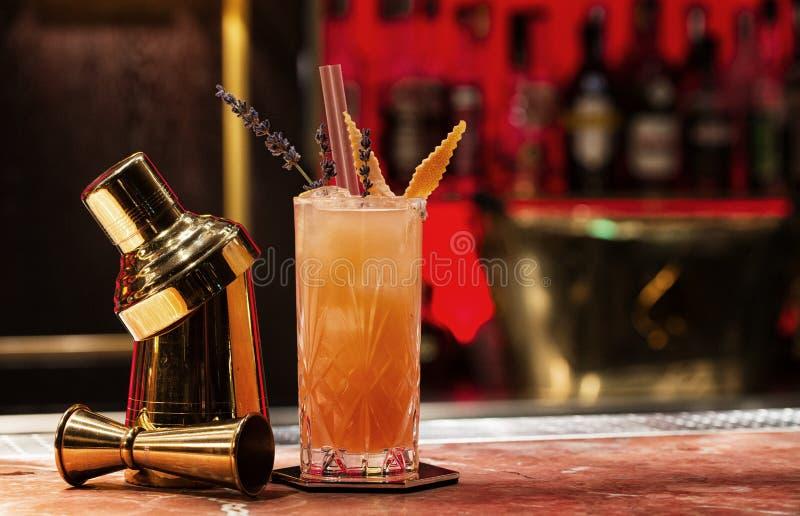 Orange cocktail with garnish stock image