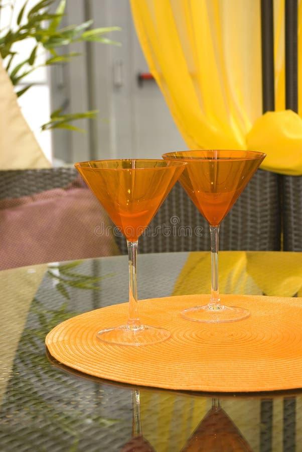 Orange cocktail glasses royalty free stock images
