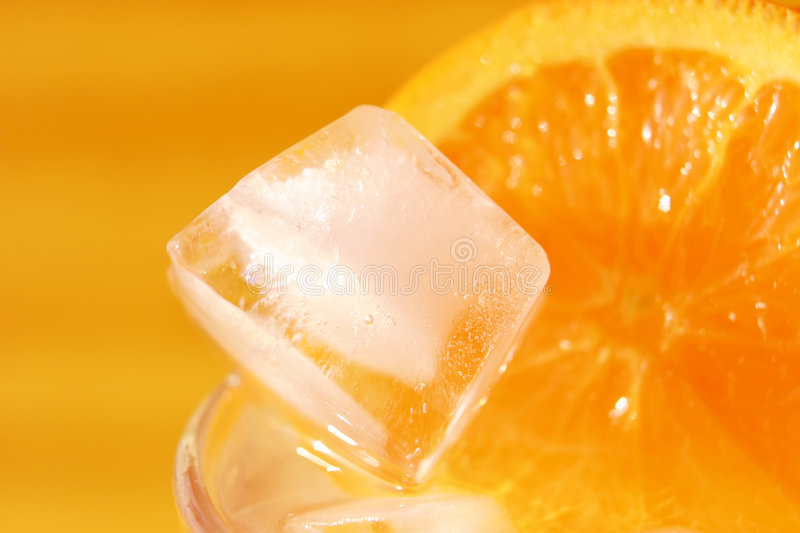 Orange cocktail with an ice royalty free stock photos