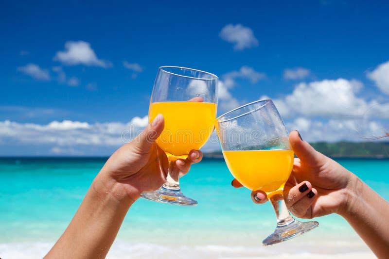 Orange Cocktails on beach royalty free stock image