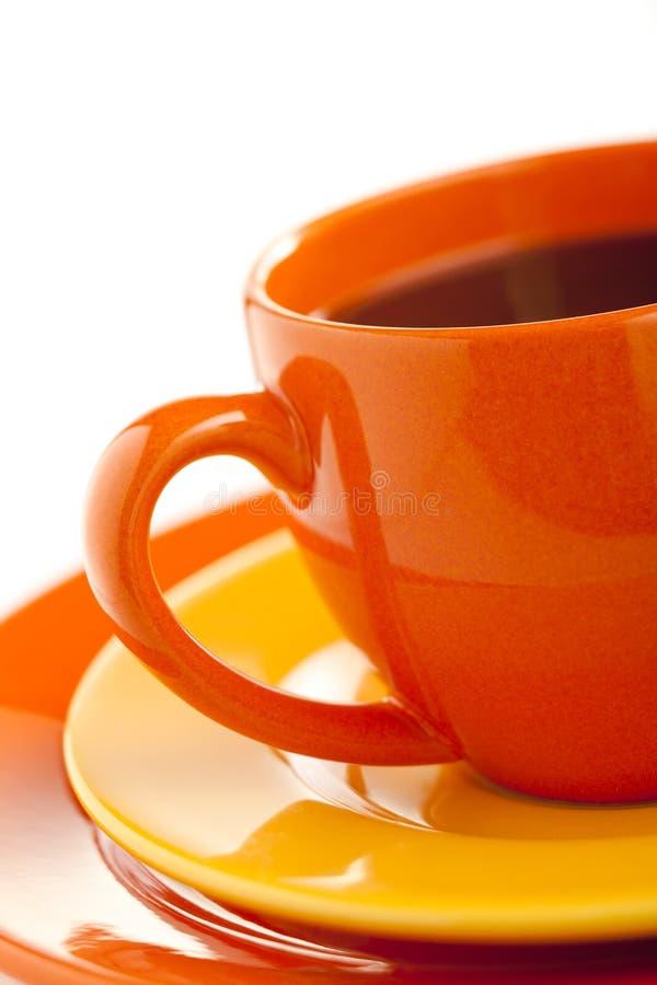 Orange coffee cup stock photo