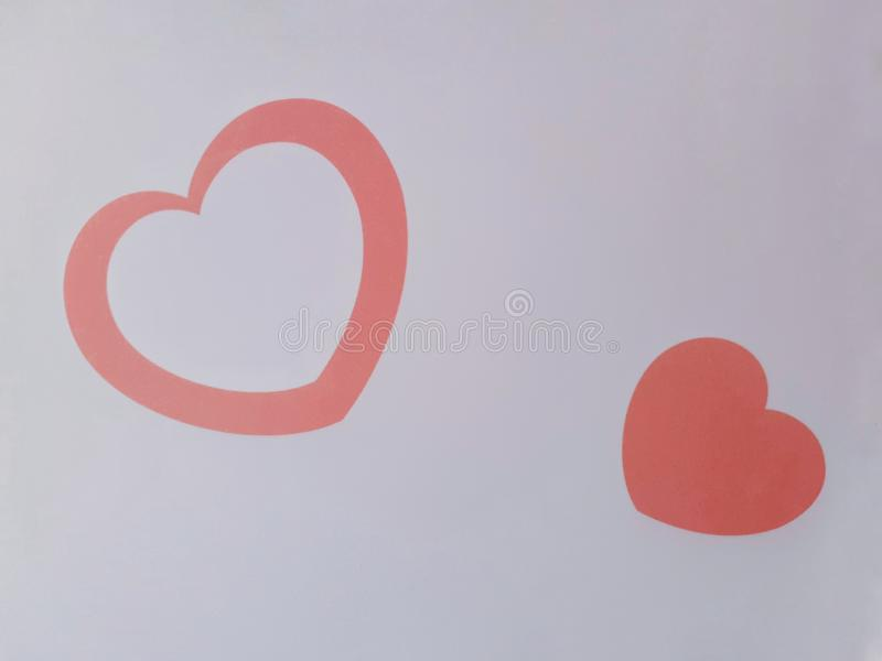 Orange color love shape on white backgound. Art, background, cat, color, cute, decoration, design, dots, geometric, gift, graphic, heart, illustration, love stock images