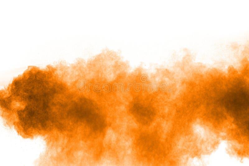 Orange color powder splatter on white background. Color particles splash. On transparent background stock photo