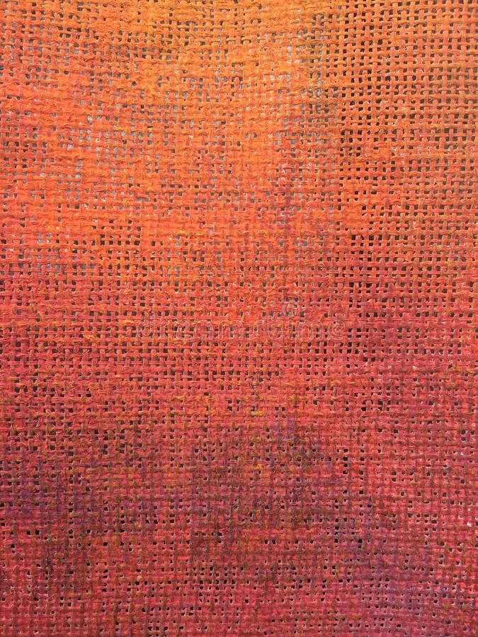 Orange colored canvas texture for interesting and creative backgrounds. stock photo