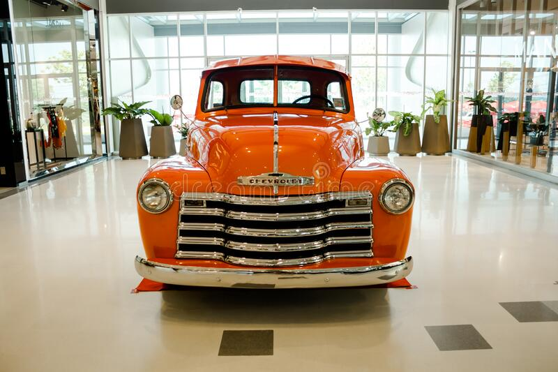 Orange colored Chevrolet stock photos