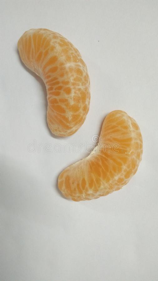 Orange colour slices of indian fruit royalty free stock photography