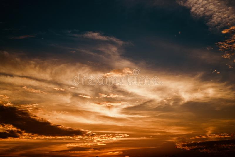Orange coloured dramatic afternoon sky photograph. A beautiful orange coloured natural cloudy afternoon sky isolated unique stock photograph stock photos