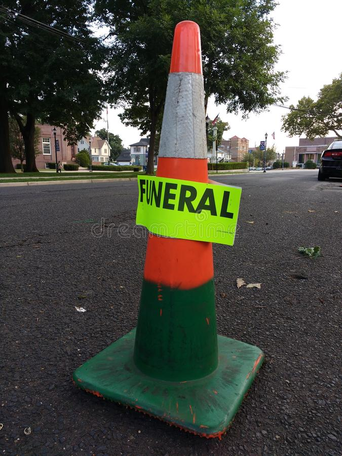 Funeral Parking, Reflective Orange Traffic Cone royalty free stock photo