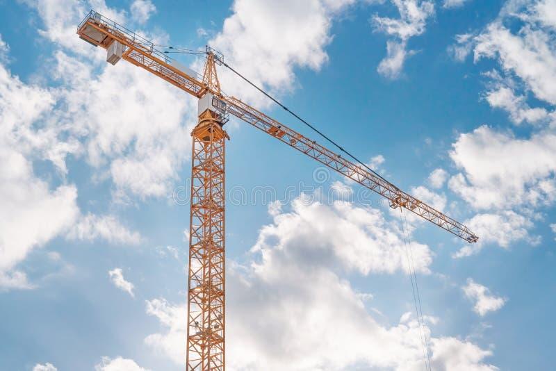 Crane against blue cloudy sky stock photography