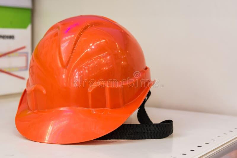 Orange construction helmet royalty free stock photo