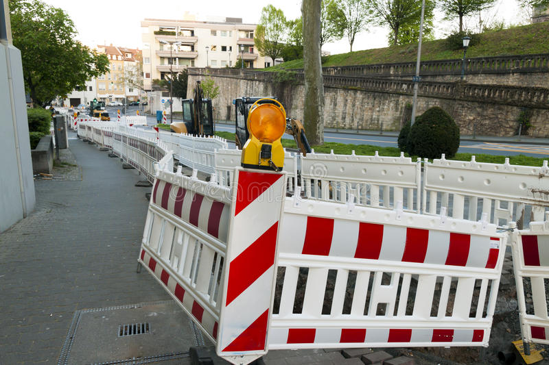 Orange construction Street barrier light on barricade. Road cons royalty free stock image