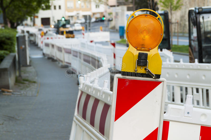 Orange construction Street barrier light on barricade. Road cons. Truction on the streets of European cities. Germany. Mainz royalty free stock photo