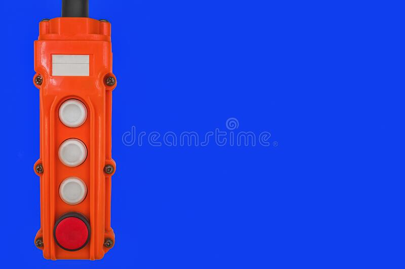 Orange control panel on a blue isolated background stock photography