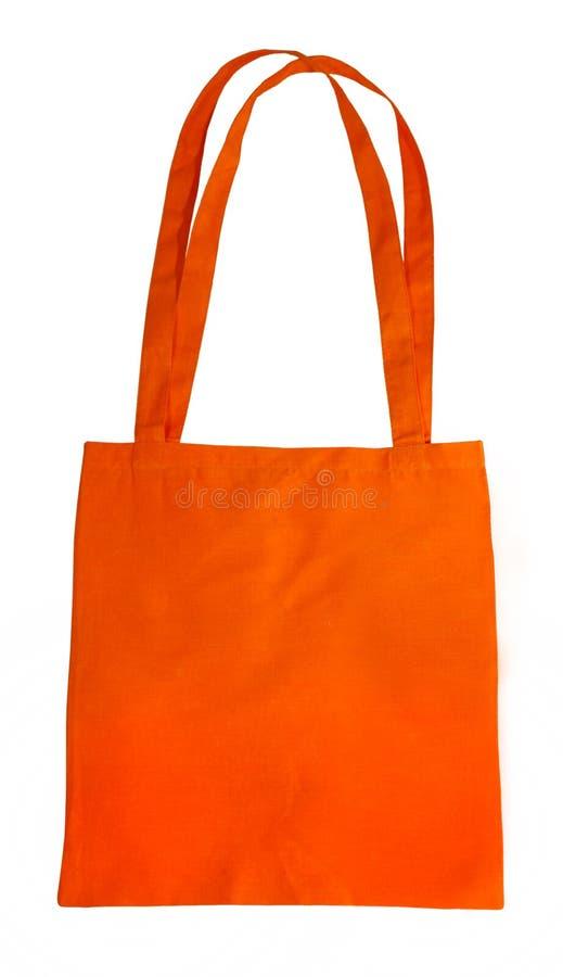 Orange cotton bag royalty free stock images