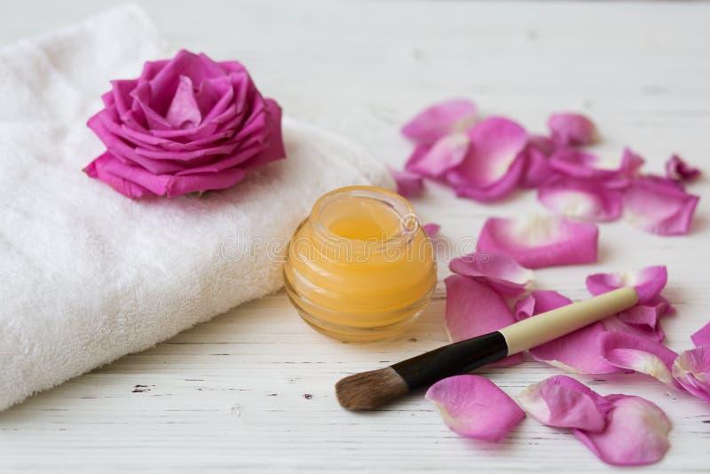Orange cream and brush with pink rose stock photos