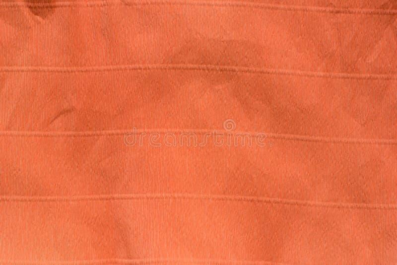 Orange creased crepe paper background texture. Orange creased crepe color paper background texture stock image