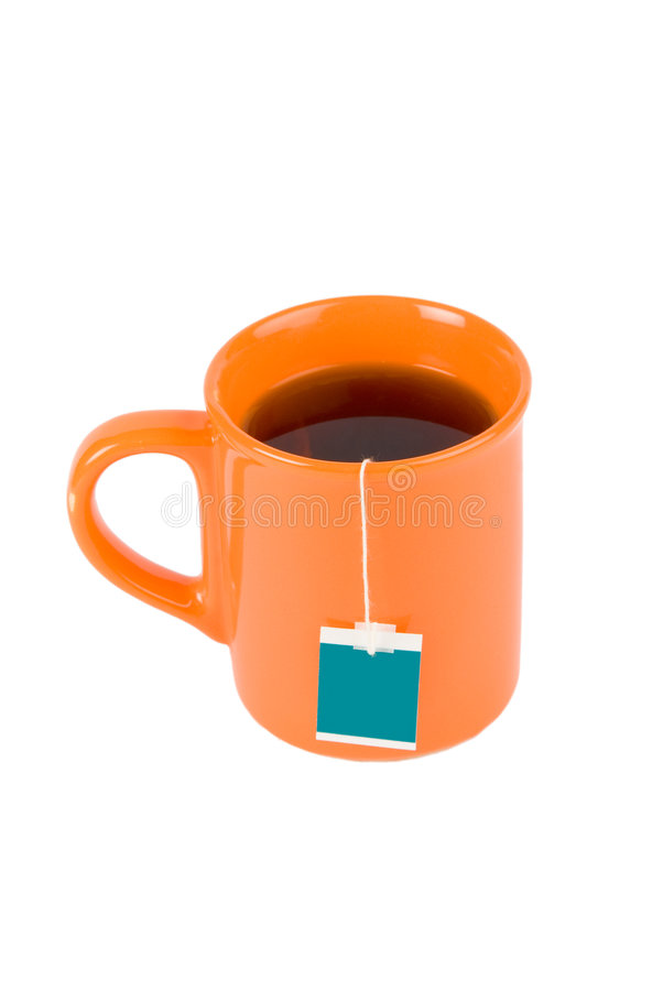 Orange cup with tea bag royalty free stock photography