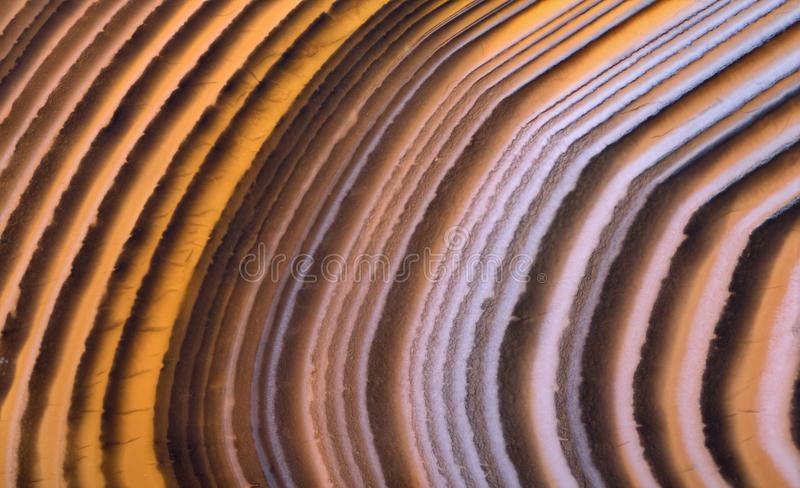 Orange curves in agate structure stock images