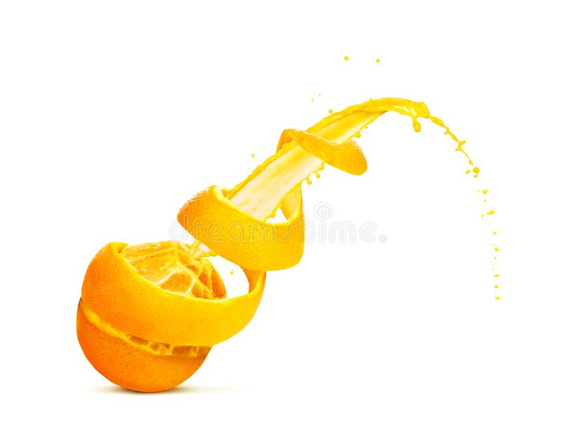 Orange with cut out skin in the form of a spiral and with a splash, isolated on a white background royalty free stock photos