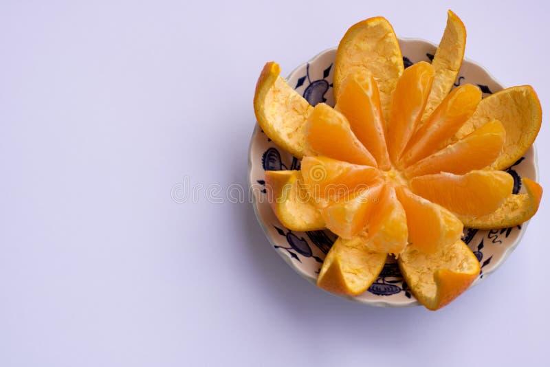 Orange cut into slices on a white background stock photo