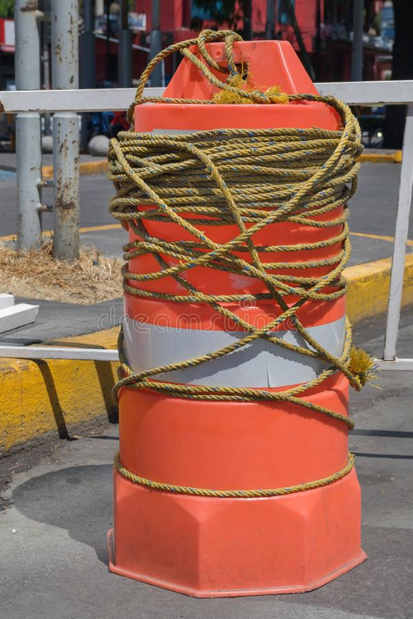 Orange cylindrical plastic structure used to control traffic. stock photos