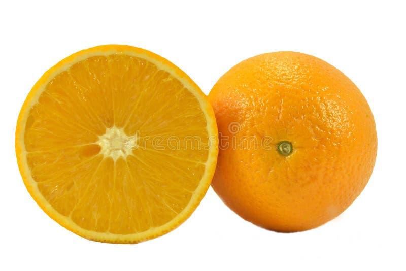 Orange dans une coupe images stock