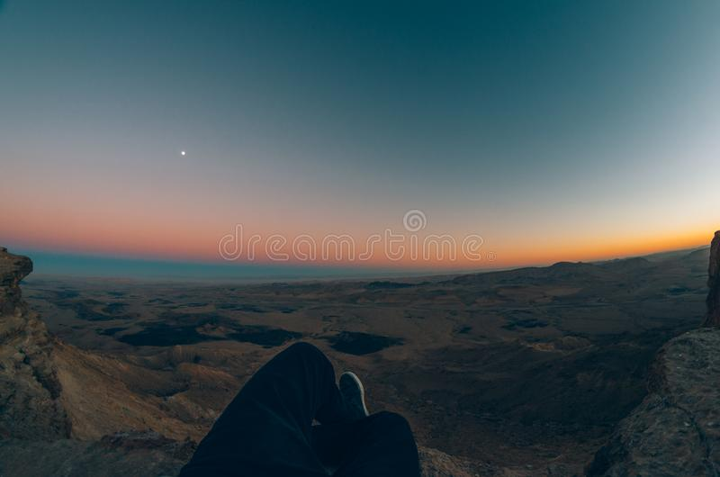 Orange dawn over dark landscape royalty free stock photos
