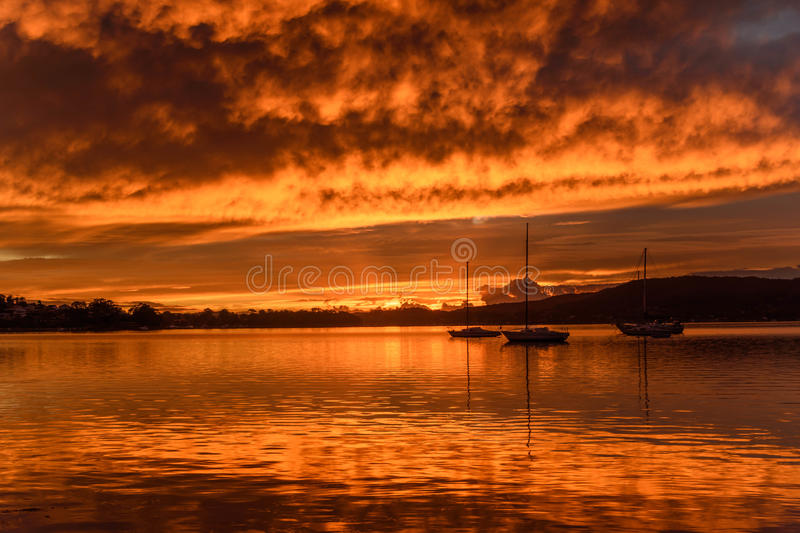 Download Orange Dawn Waterscape Over The Bay Stock Photo - Image: 91445360