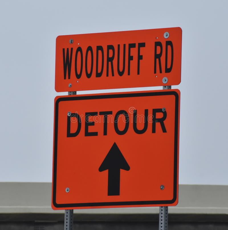 An orange detour sign on an interstate highway. Directs motorists around a large construction site stock image