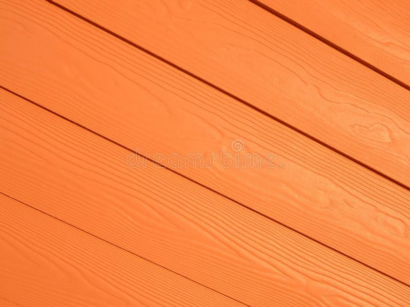 Orange Diagonal Wood Pattern Background. Colorful orange diagonal smooth pattern background royalty free stock images