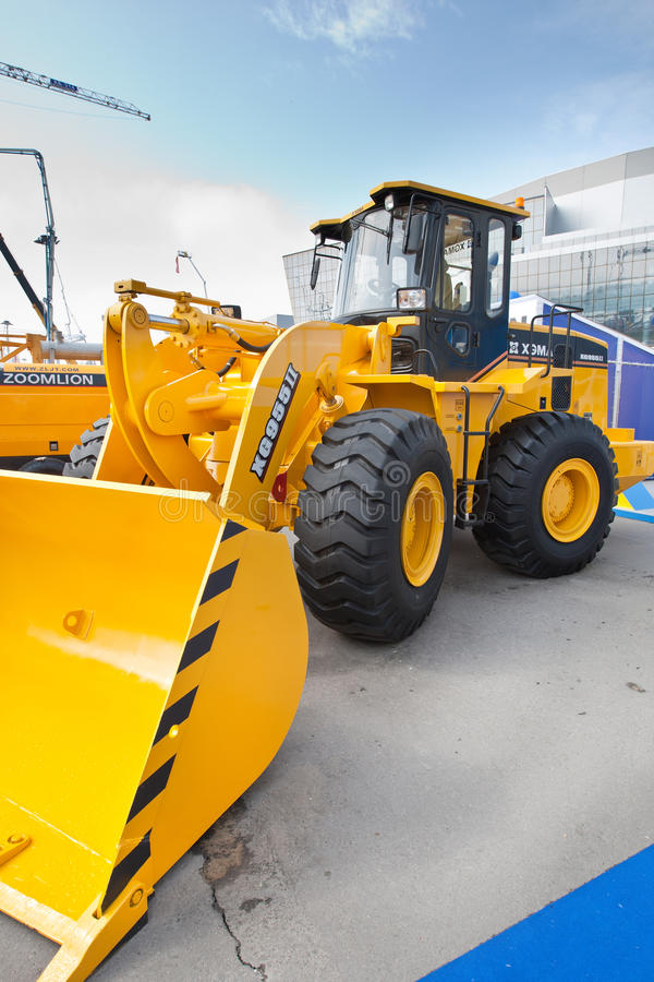 Orange diesel front end loade. MOSCOW, RUSSIA - JUNE 02: Orange diesel front end loader on display at Moscow International exhibition Construction equipment and stock image