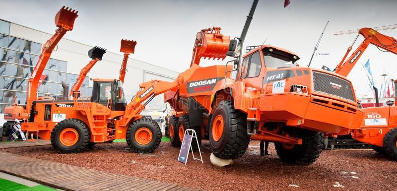 Orange diesel front end loader on display stock images