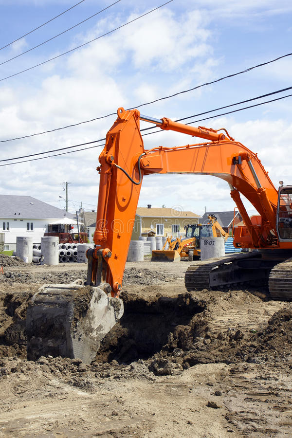 Download Orange Digger And Deep Hole Stock Image - Image of dirt, ground: 19981517