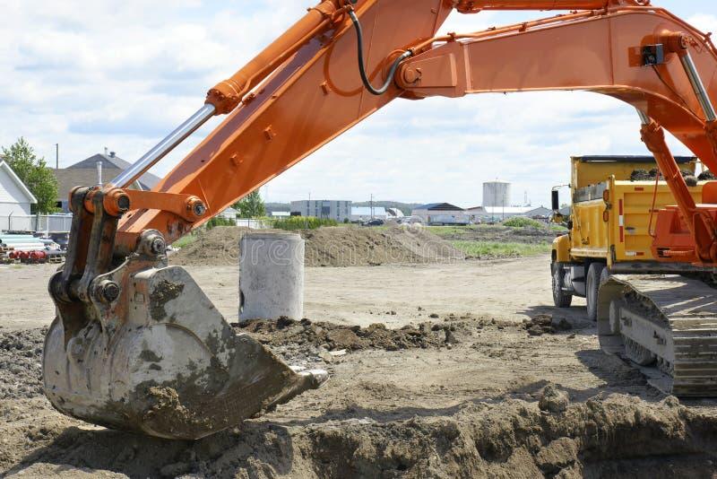 Download Orange Digger And Yellow Dump Truck Stock Photo - Image of bucket, dirt: 20329080