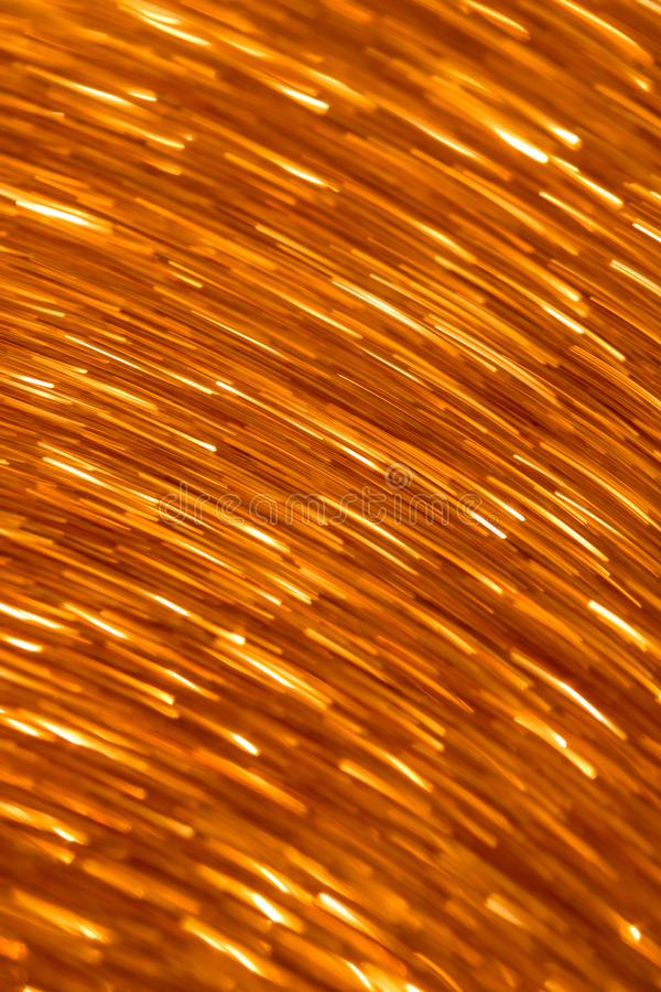 Orange dimic light lines background. Abstract wallpaper trend. Fire spark imitation stock image